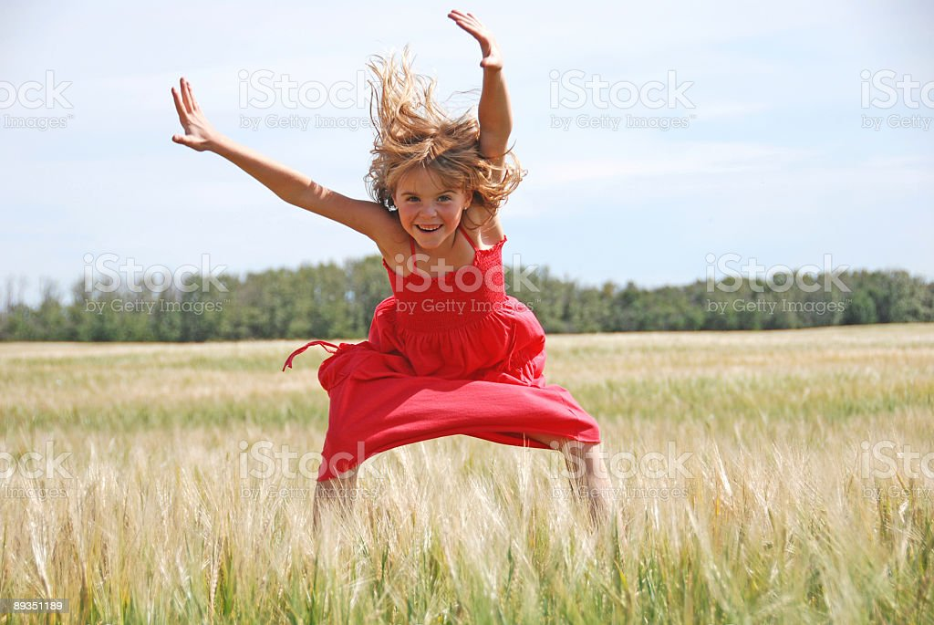 happy girl jumps for joy royalty-free stock photo