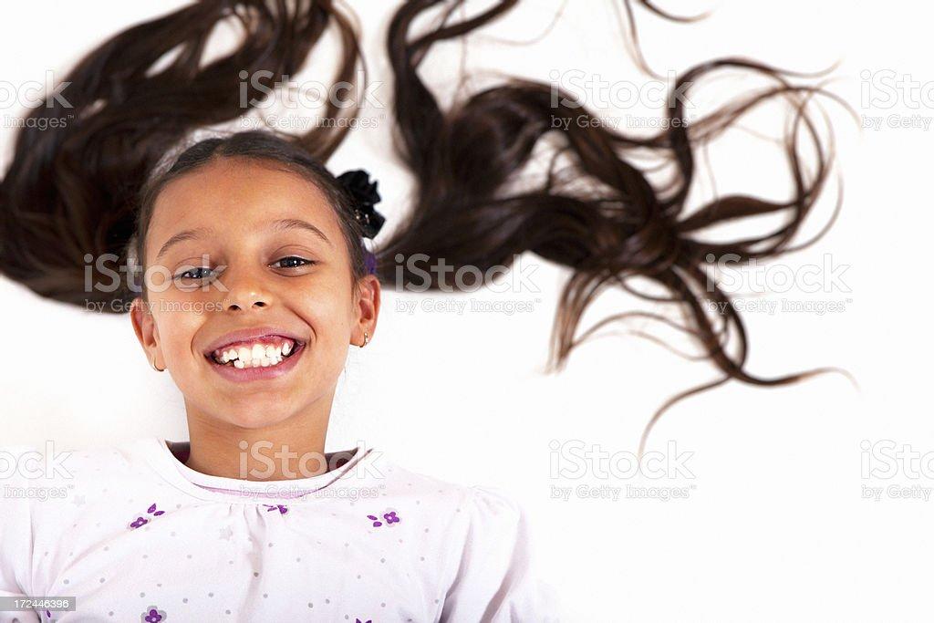 Happy Girl lying on a floor royalty-free stock photo