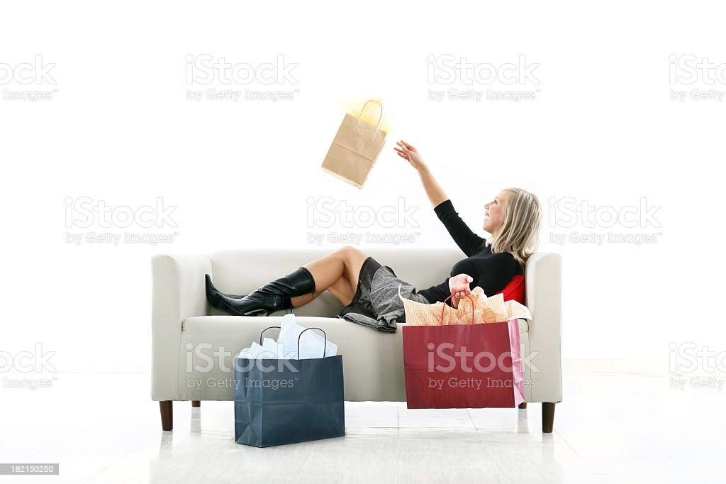 Happy girl on a sofa royalty-free stock photo