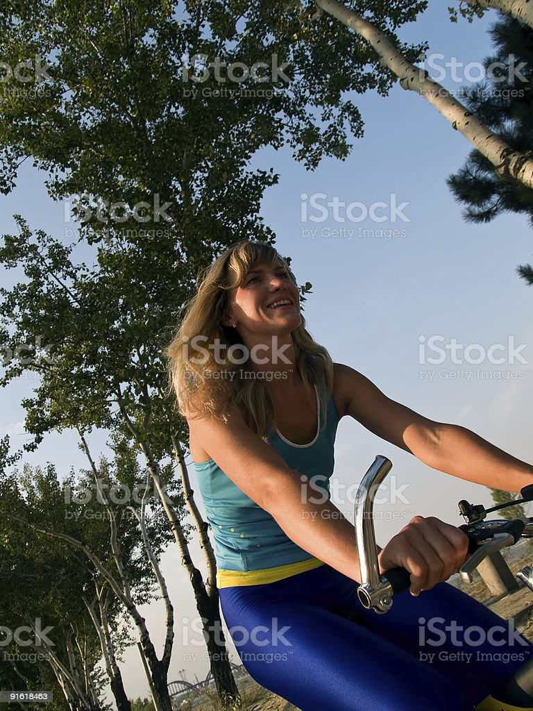 Happy girl on bicycle royalty-free stock photo