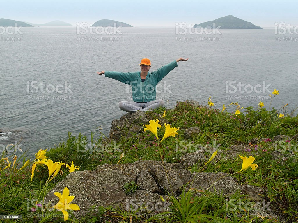 happy girl  on the rock with arms wide open royalty-free stock photo