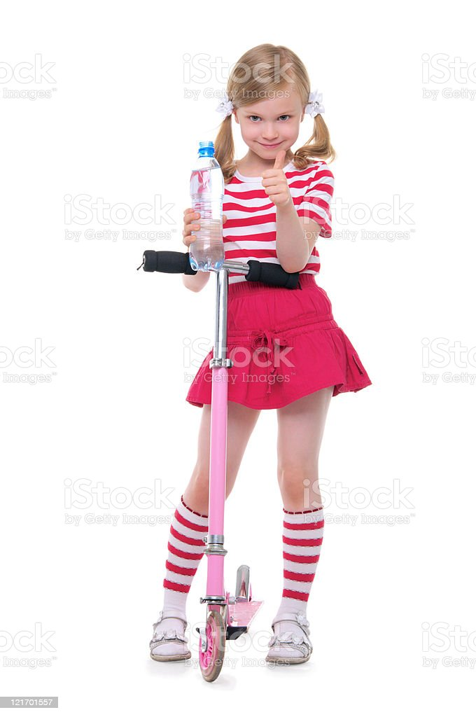 Happy girl on the scooter with a bottle of water royalty-free stock photo