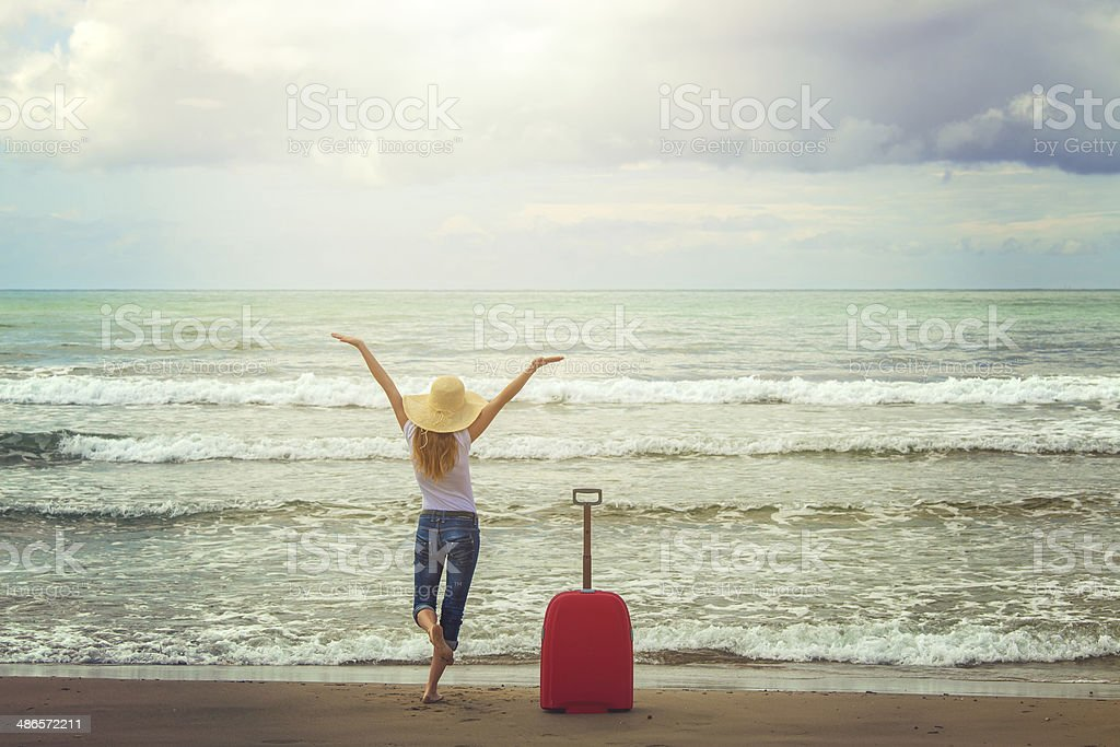 happy girl on vacation at the sea stock photo