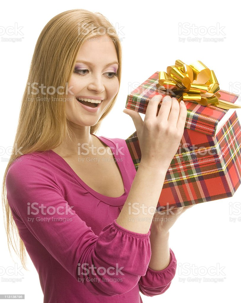 Happy girl opening a gift box. royalty-free stock photo