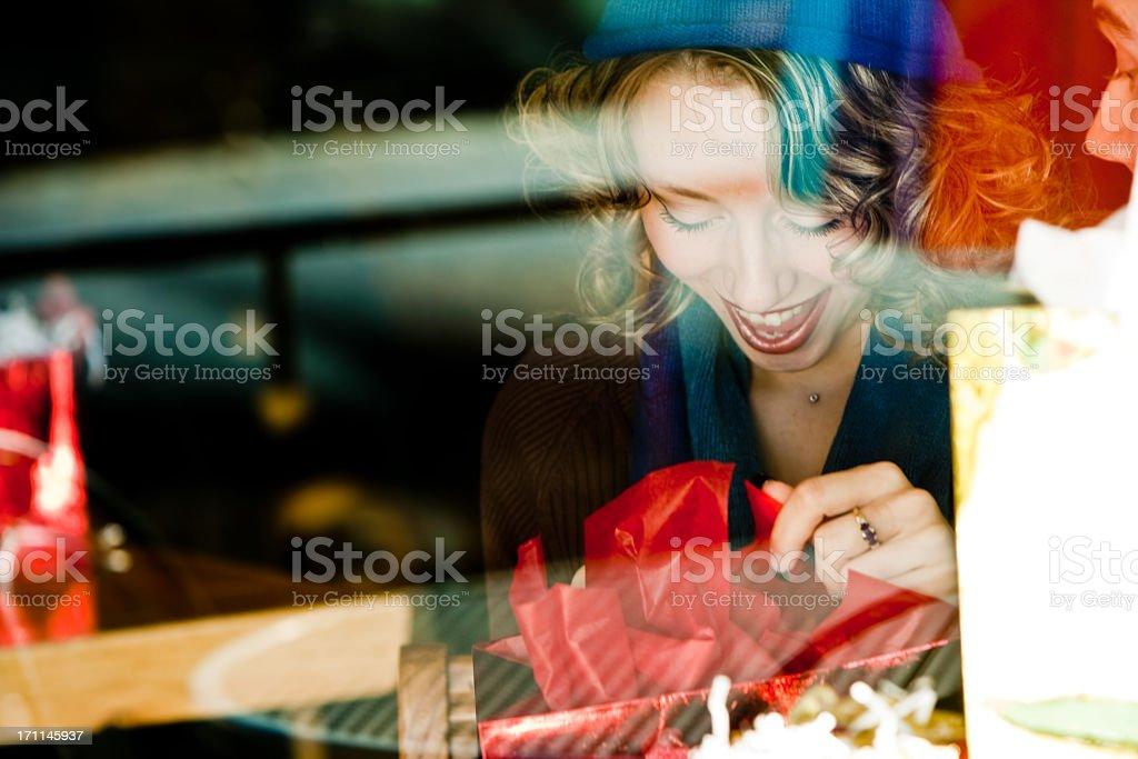 Happy Girl Opening Gift Through Window royalty-free stock photo