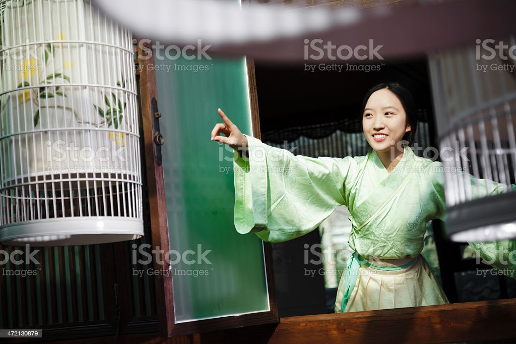 Happy girl opening the wooden window royalty-free stock photo
