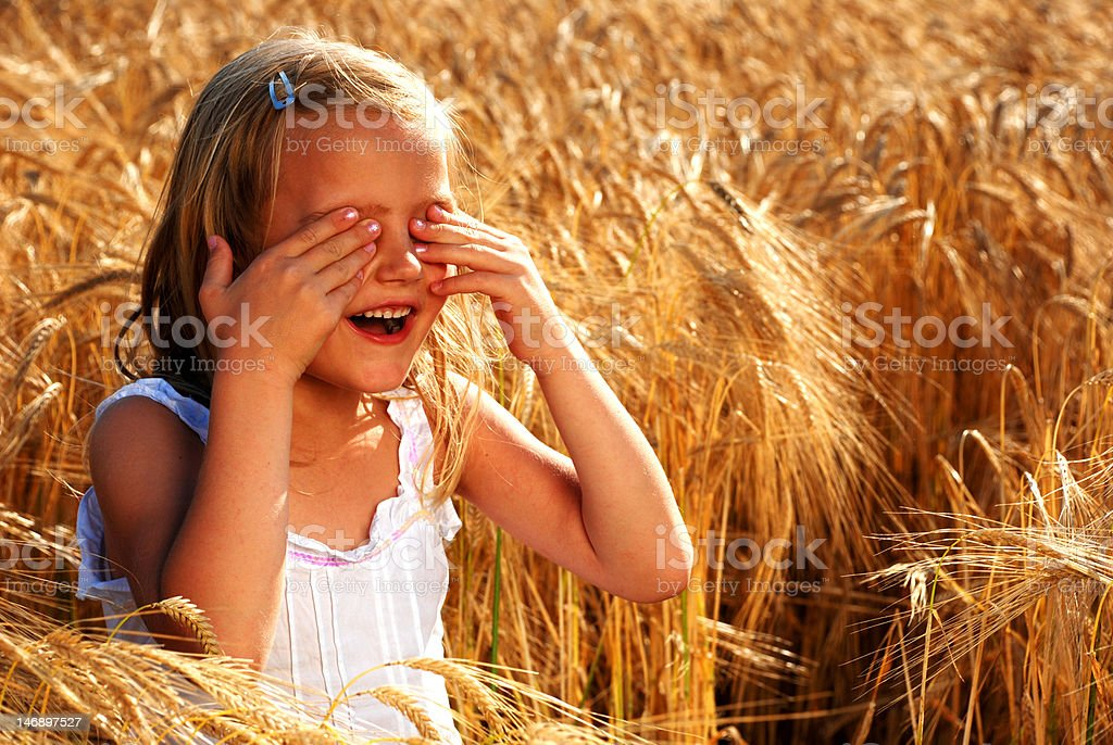 Happy girl playing hide and seek royalty-free stock photo