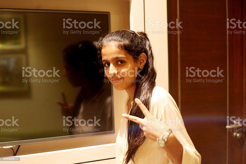 Happy girl portrait indoor stock photo
