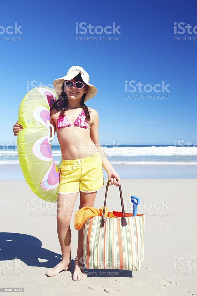 Happy girl ready for fun in the sun royalty-free stock photo