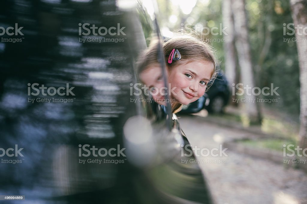 Happy girl reflected in the car. stock photo