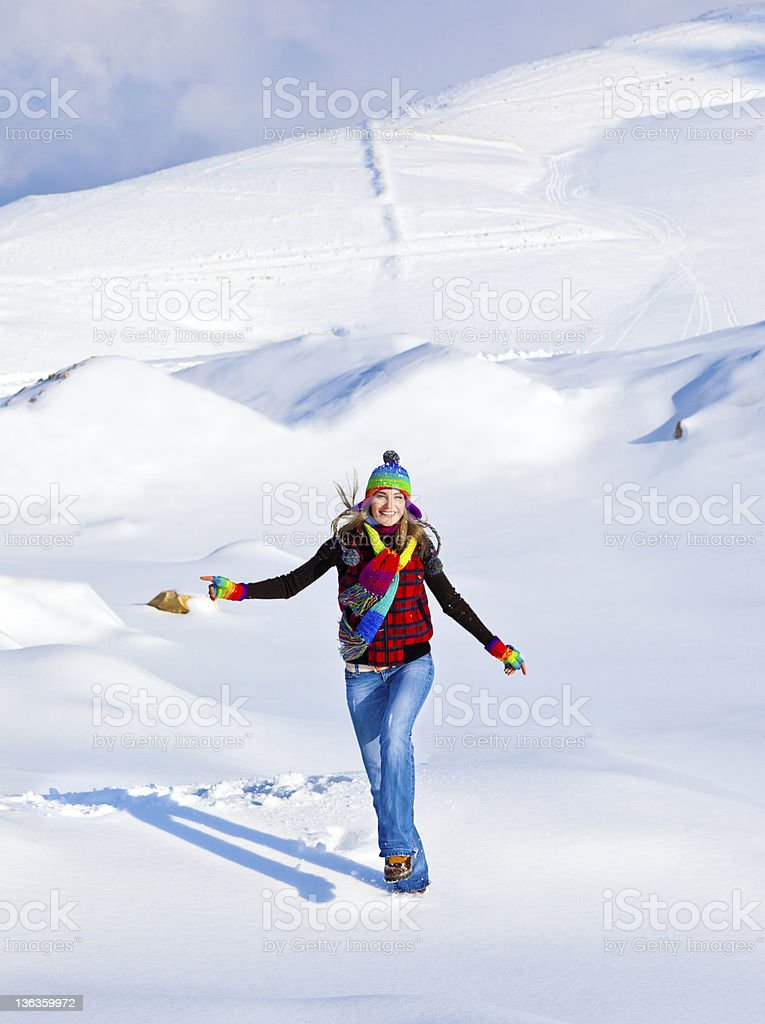 Happy girl running in the snow royalty-free stock photo