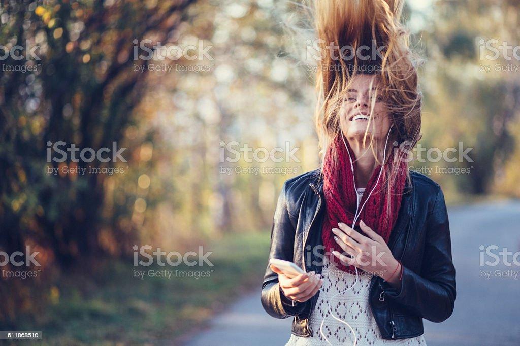 Happy girl shaking head to music stock photo