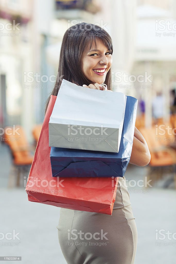 Happy girl shopping in the city royalty-free stock photo
