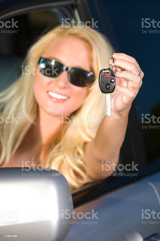 Happy Girl Showing Keys to New Car royalty-free stock photo