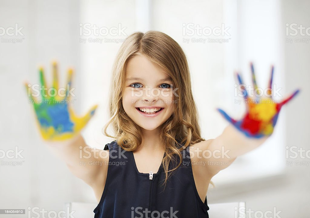 happy girl showing painted hands stock photo