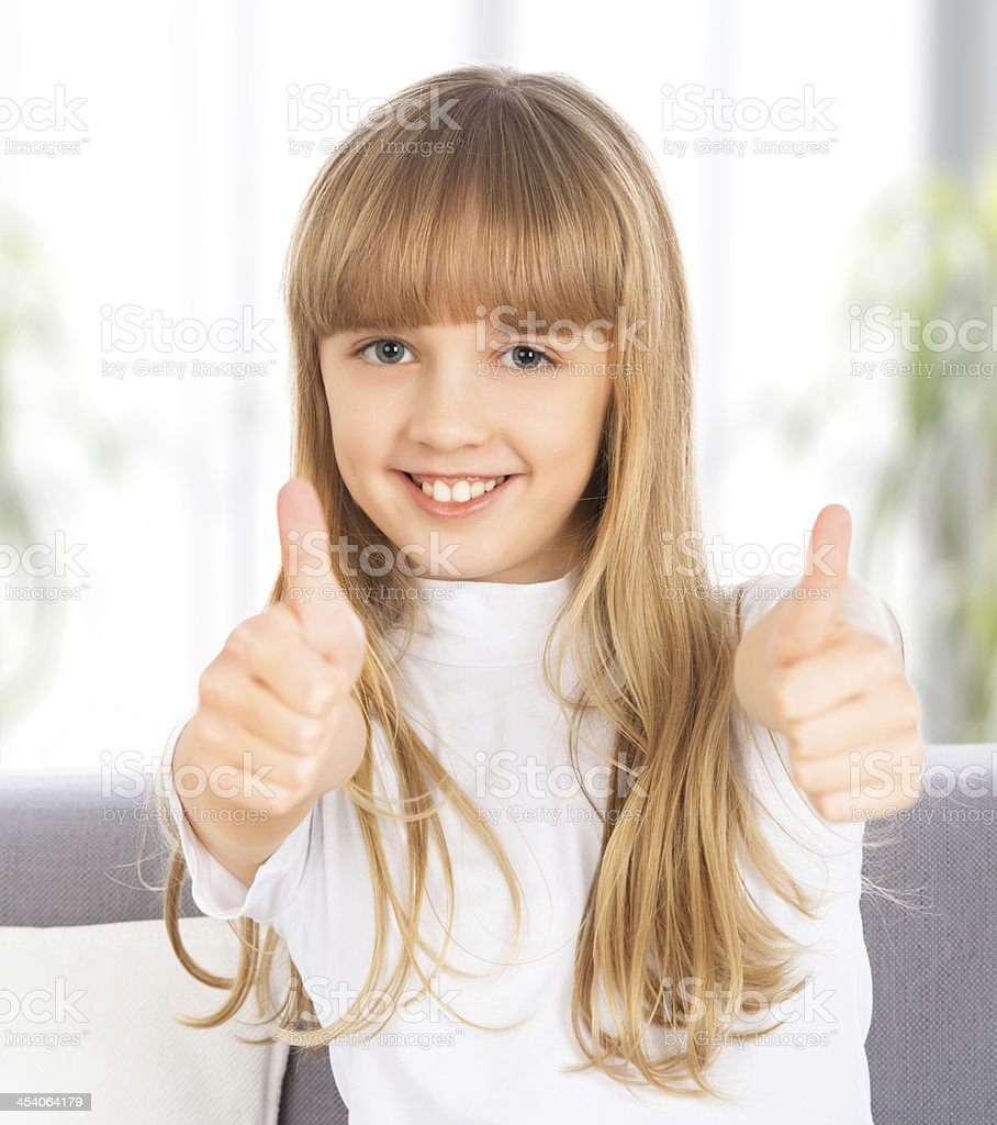 happy   girl shows a thumbs up royalty-free stock photo