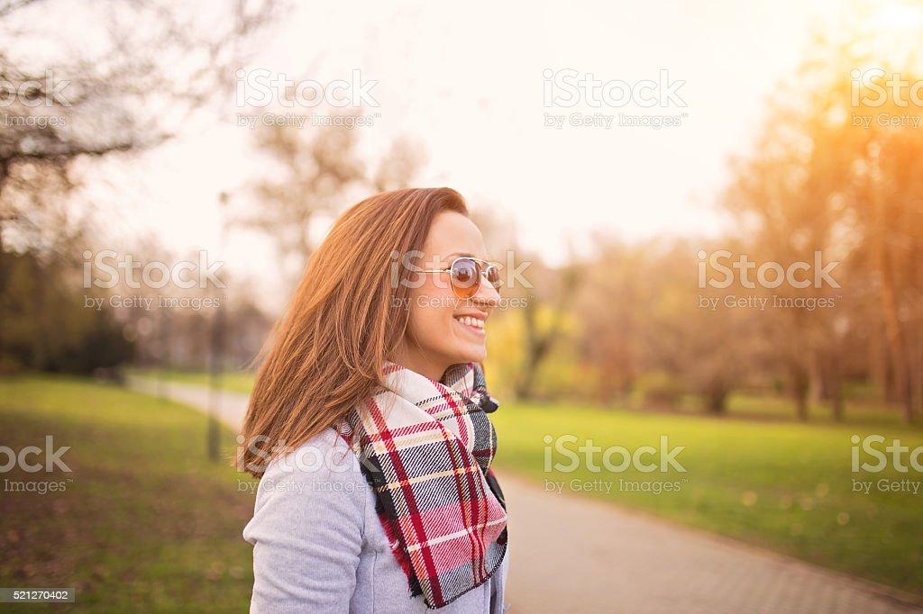Happy girl smiling in park stock photo
