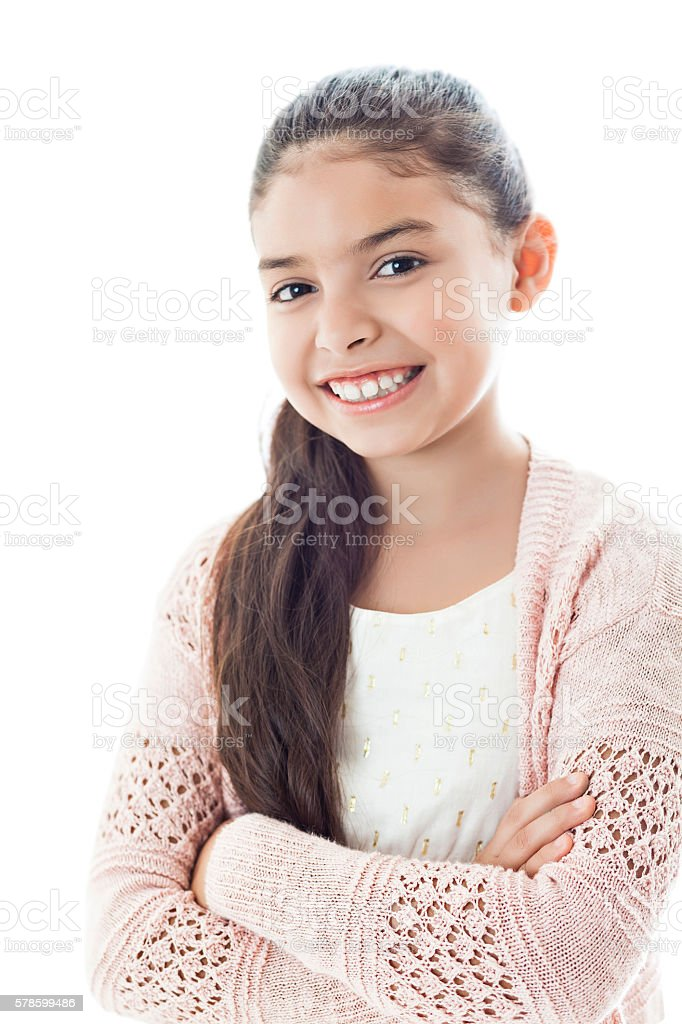 Happy girl smiling with her arms crossed at the camera stock photo