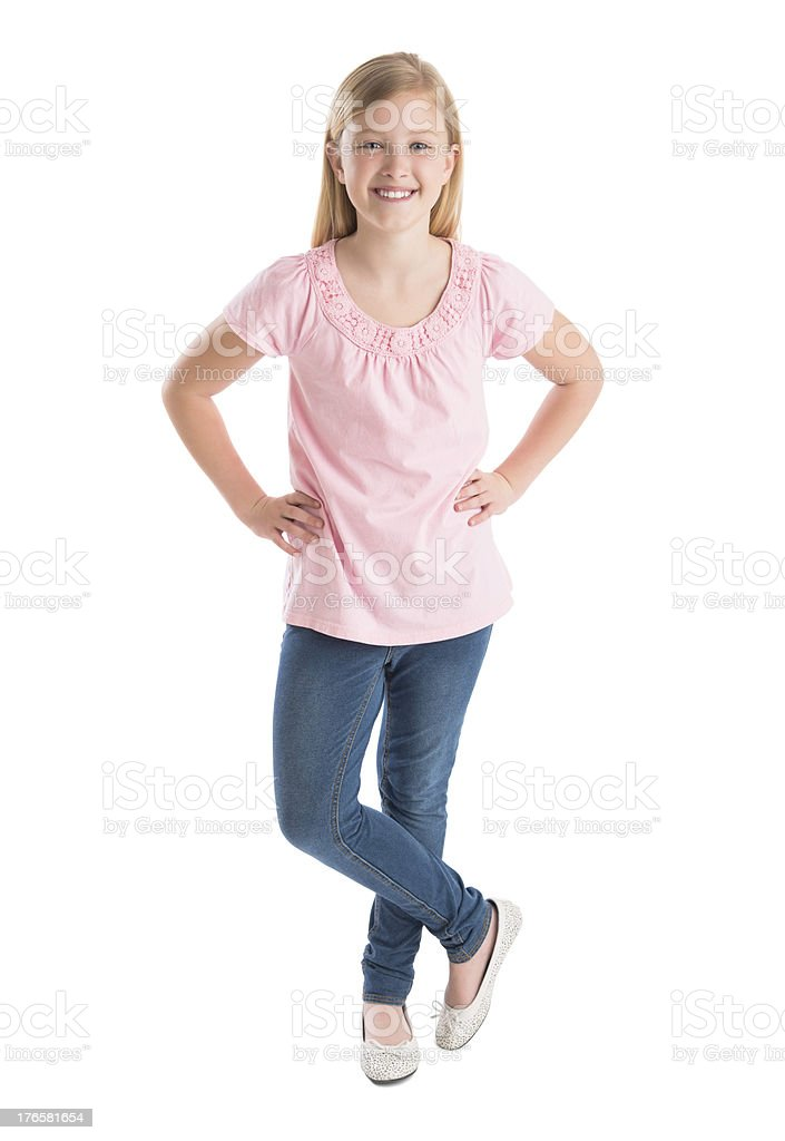Happy Girl Standing With Hands On Hip stock photo