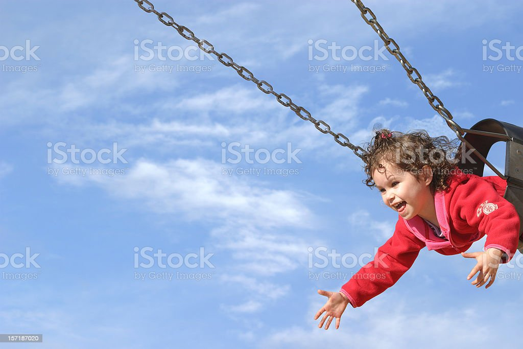 Happy Girl Swinging stock photo