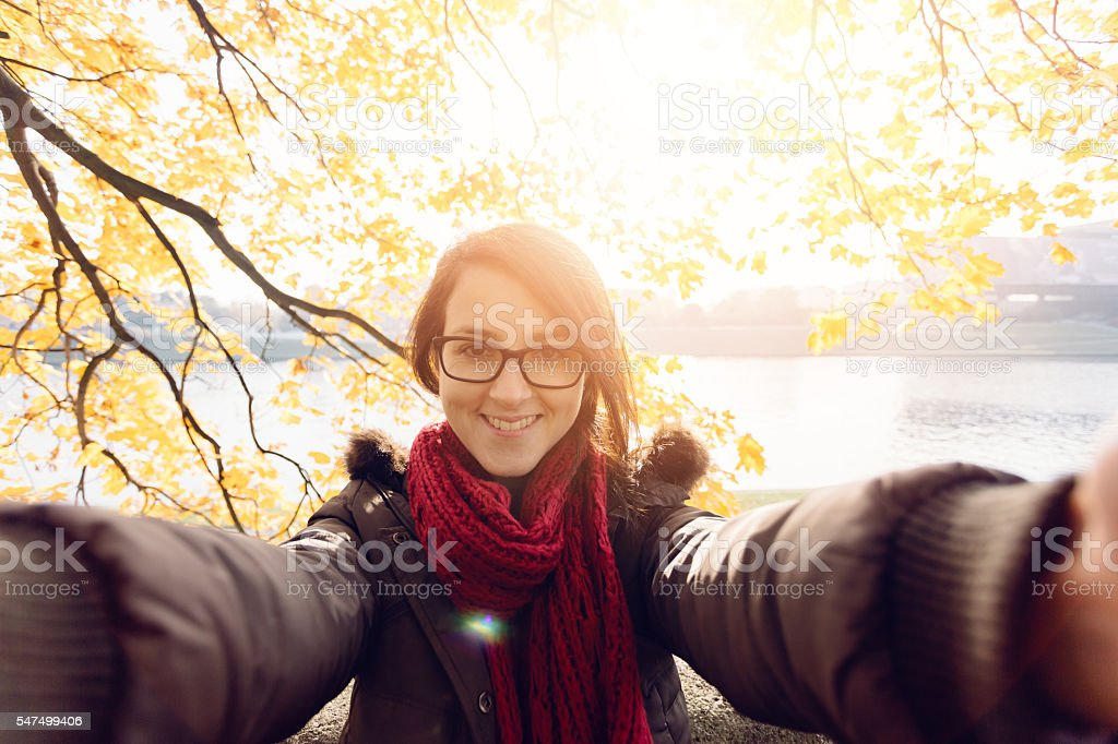 Happy girl taking a selfie among nature stock photo