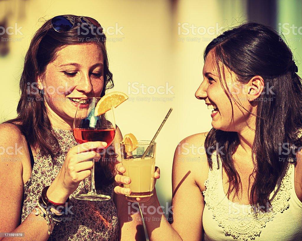 Happy Girl toasting at bar stock photo