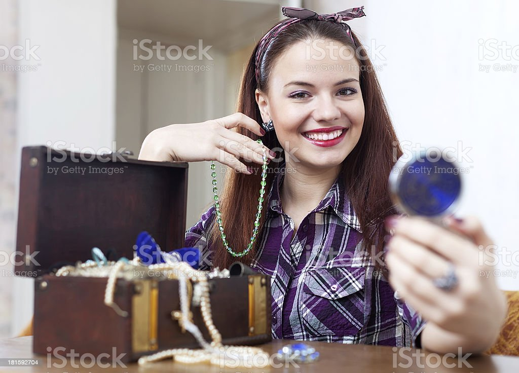 happy girl tries necklace royalty-free stock photo