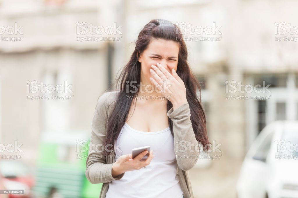 Happy girl using cellphone outdoors. stock photo