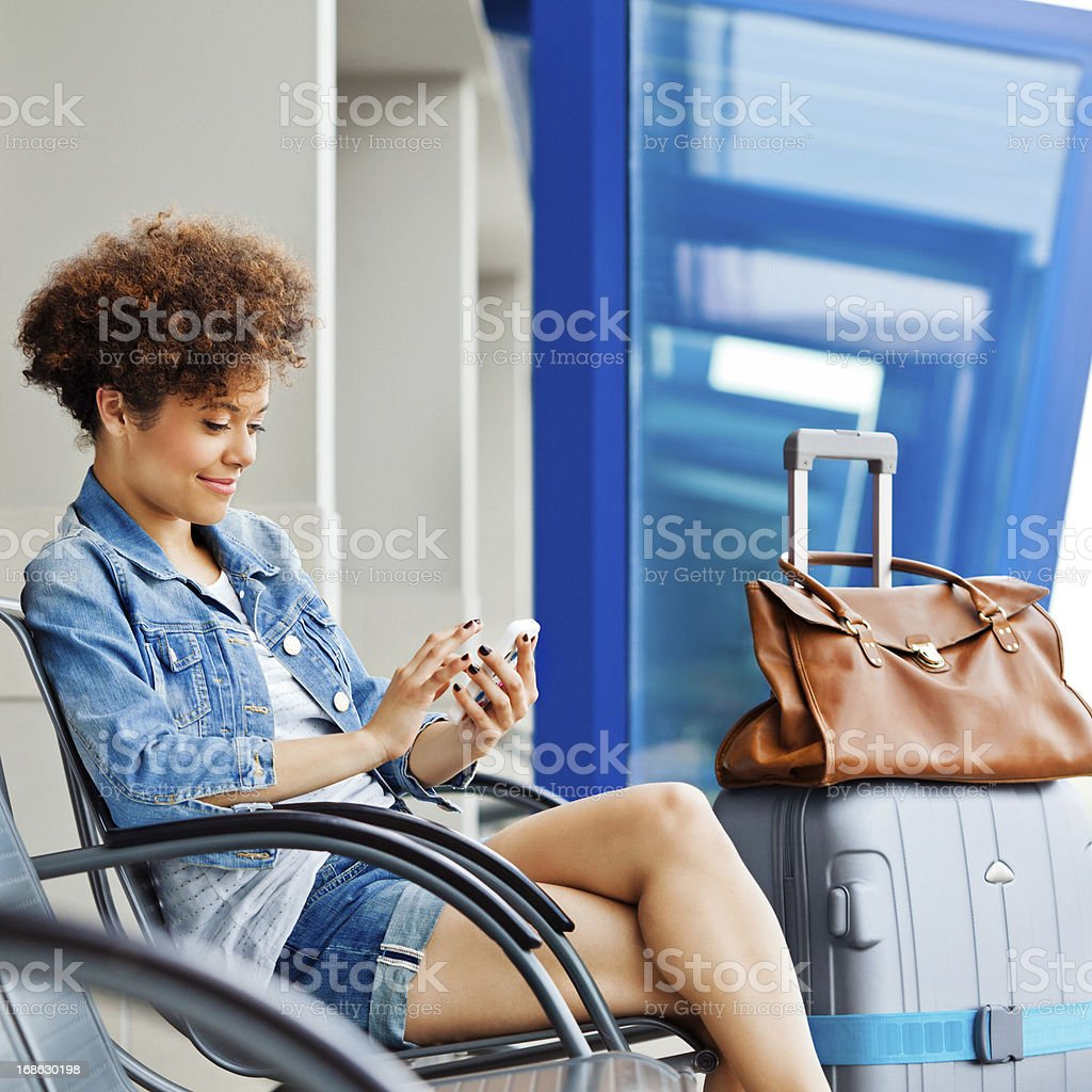 Happy girl waiting for flight royalty-free stock photo