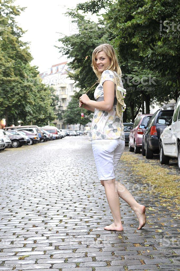 Happy girl walking barefoot royalty-free stock photo