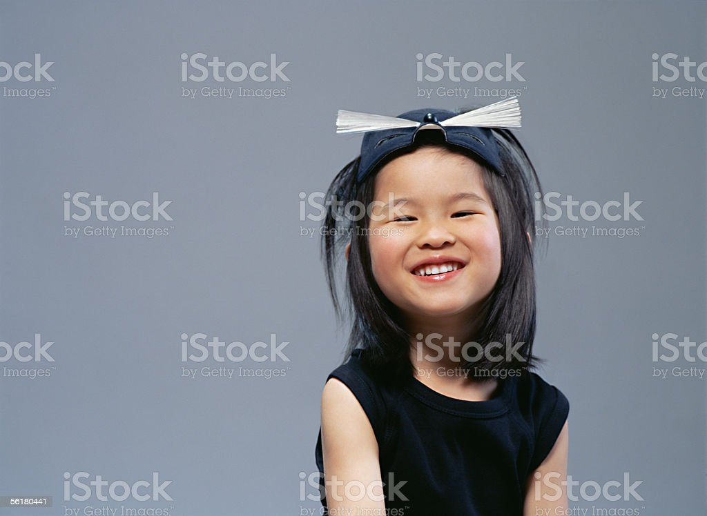 Happy girl wearing a cat costume stock photo