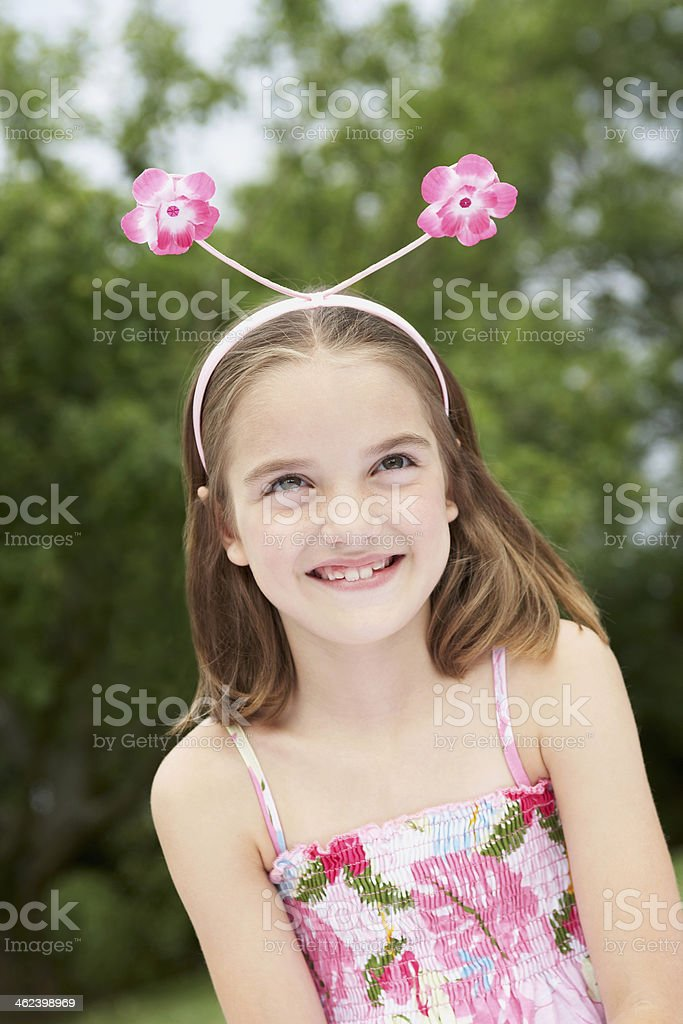 Happy Girl Wearing Floral Deely Boppers stock photo