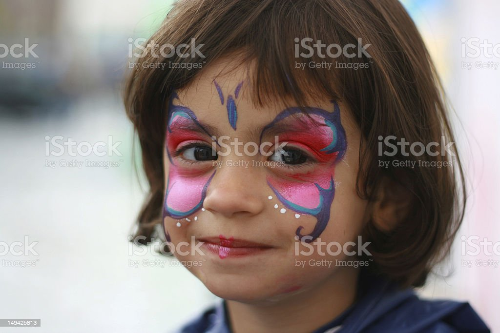 Happy girl with a painted sface royalty-free stock photo