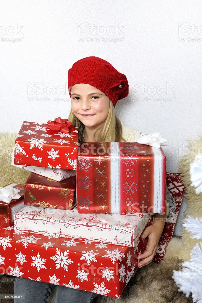happy girl with a pile of Christmas presents royalty-free stock photo