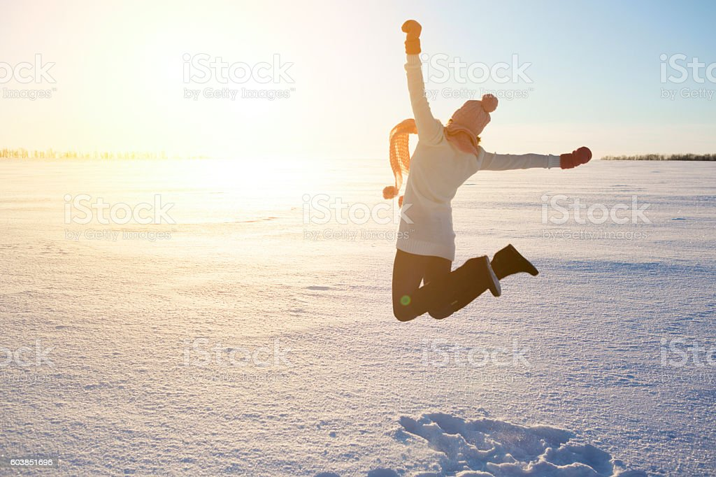 Happy girl with a red scarf on the winter stock photo