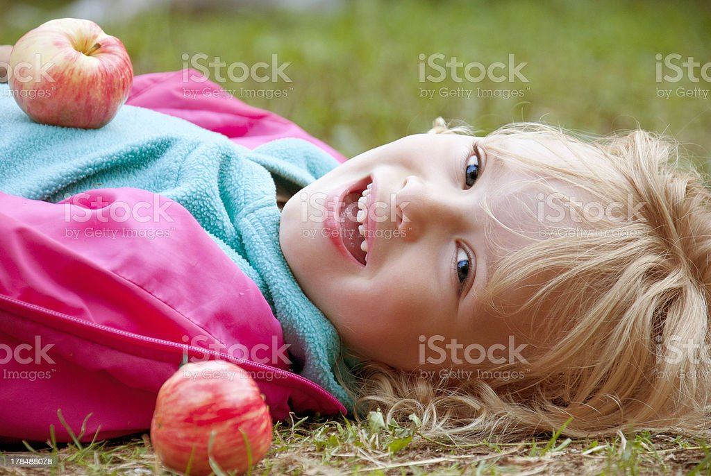 Happy girl with apples stock photo