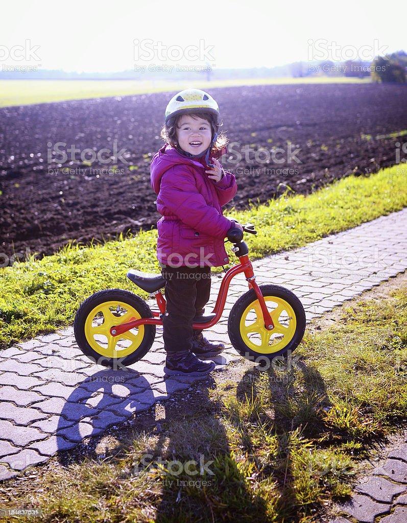 Happy girl with balance bike royalty-free stock photo