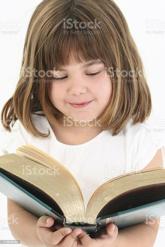 Happy Girl With Big Book stock photo