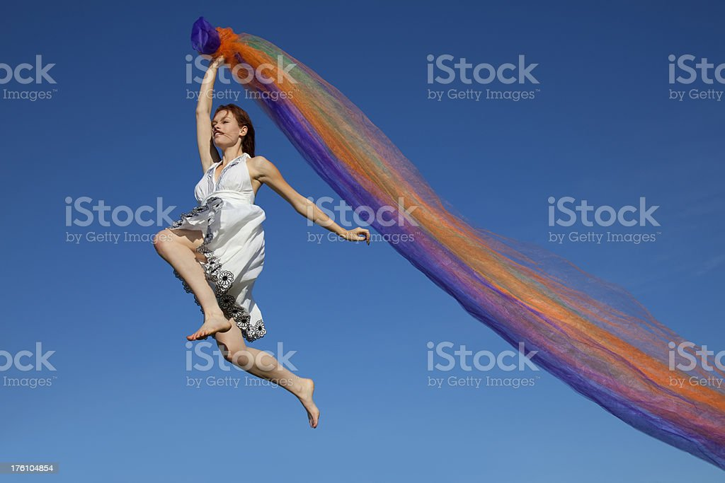 Happy Girl With Colorful Fabric Running, Jumping, Blue Sky Background royalty-free stock photo