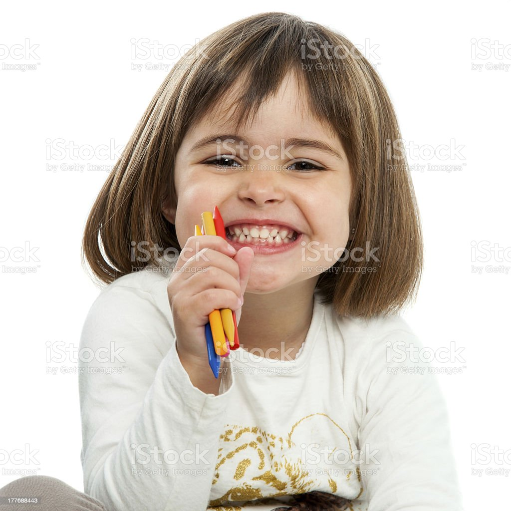 Happy girl with crayons. royalty-free stock photo