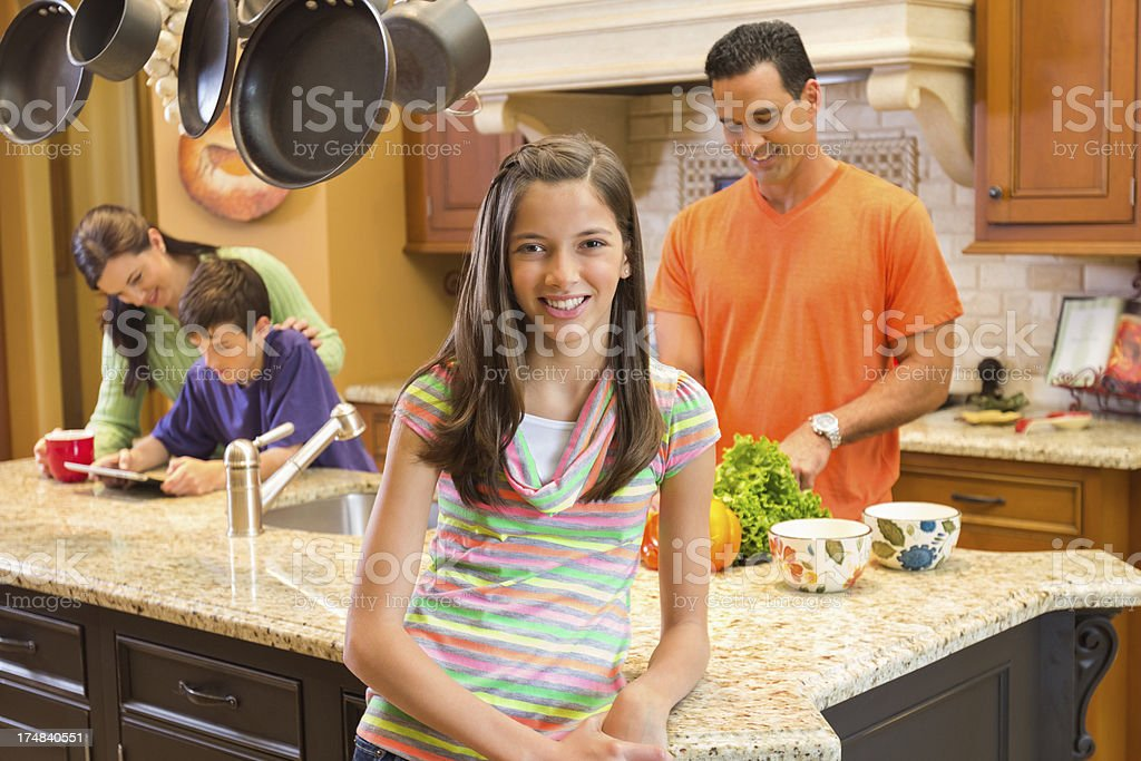 Happy Girl With Family In Domestic Kitchen royalty-free stock photo
