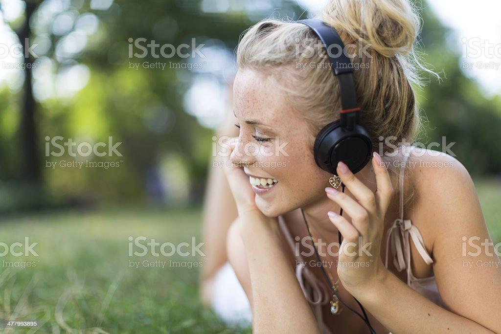 Happy girl with headphones royalty-free stock photo