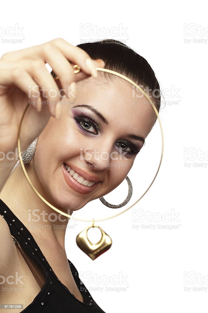 Happy girl with heart shaped necklace in her hand royalty-free stock photo