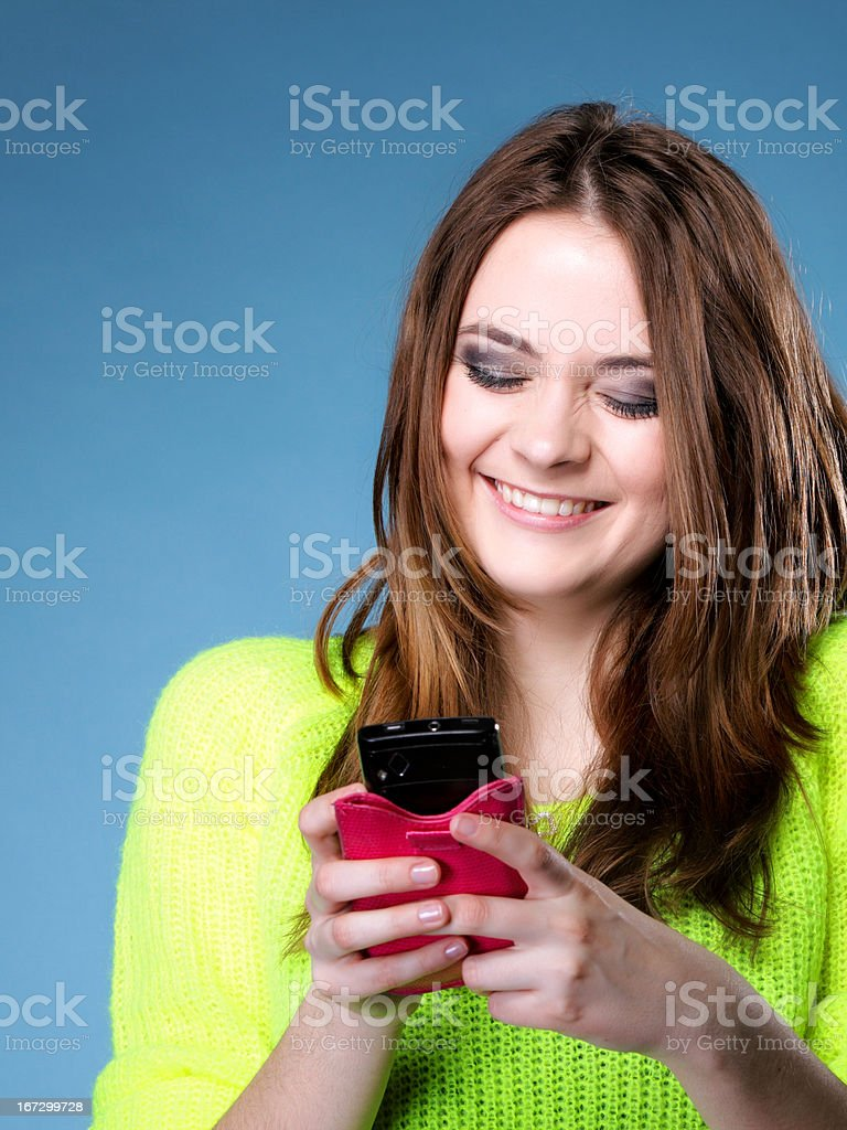 Happy girl with mobile phone reads message royalty-free stock photo