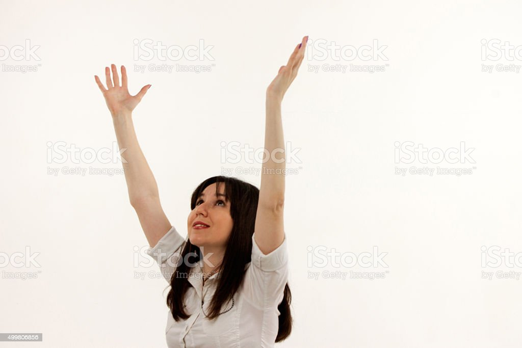 happy girl with raised arms on a white background stock photo