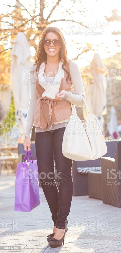 Happy girl with shopping bags royalty-free stock photo
