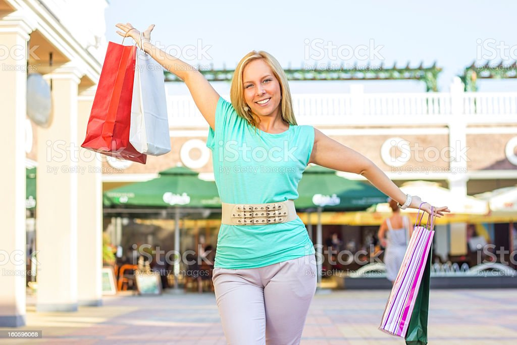 Happy girl with shopping bags. royalty-free stock photo