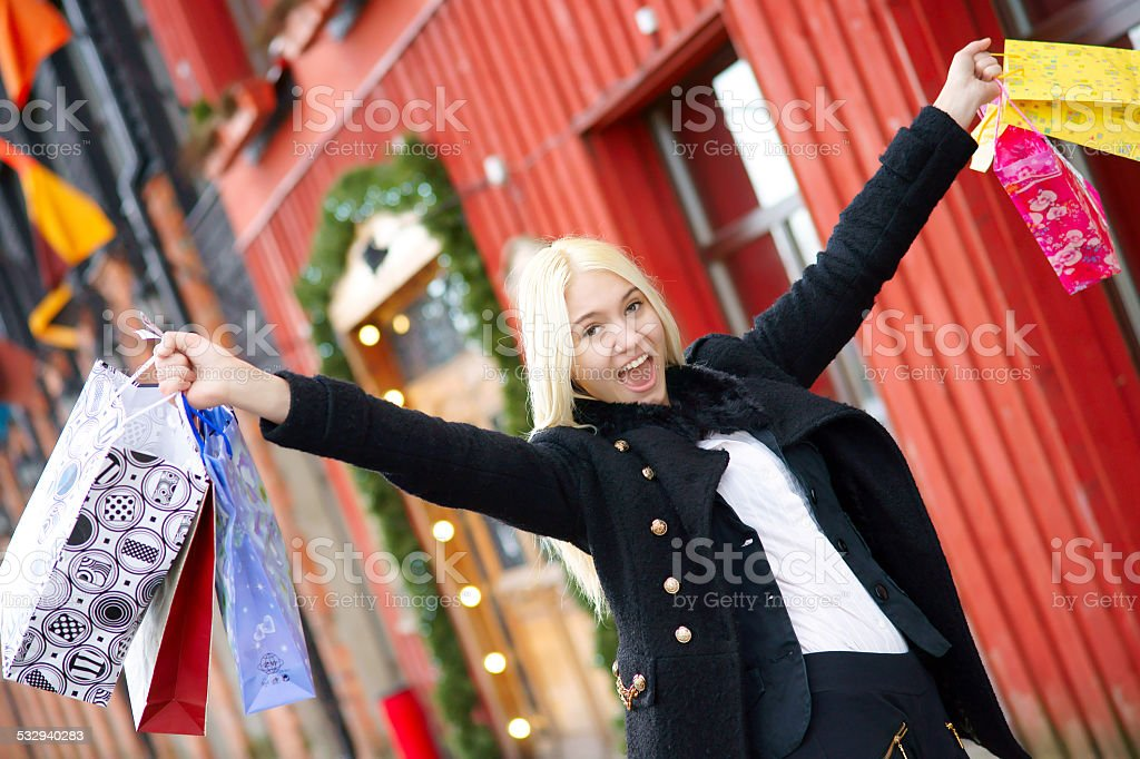 Happy girl with shopping bags screaming stock photo