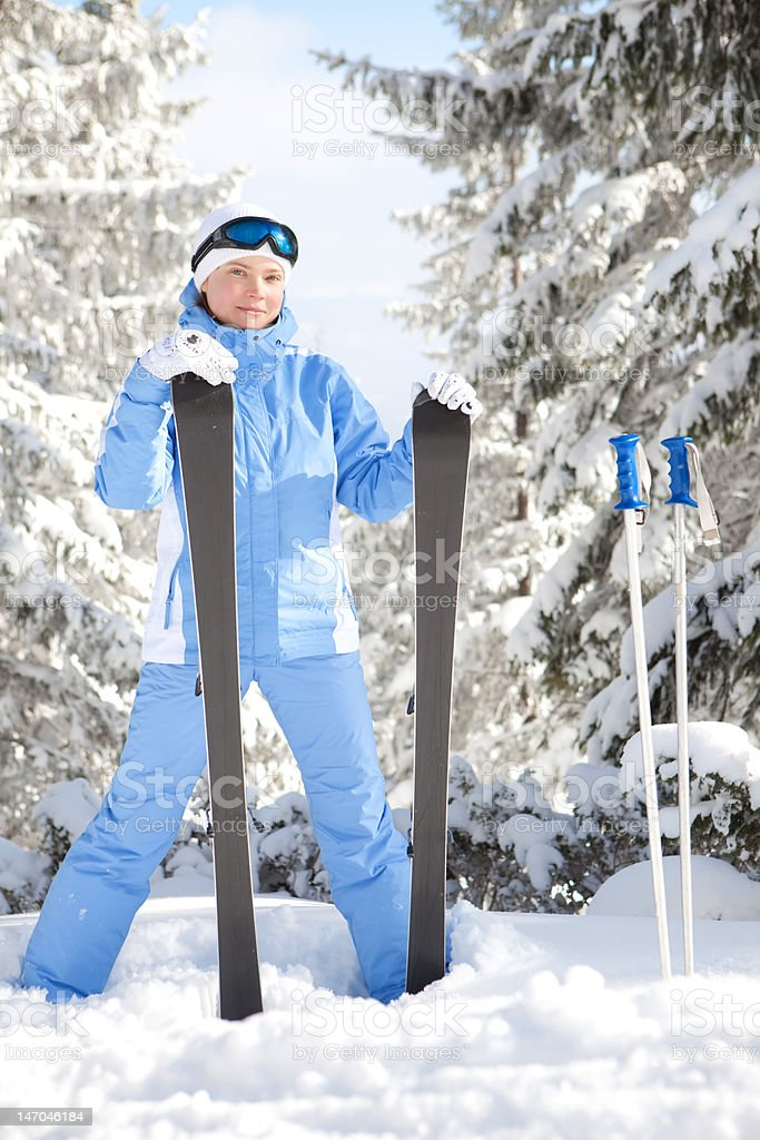Happy girl with ski in the winter landscape royalty-free stock photo