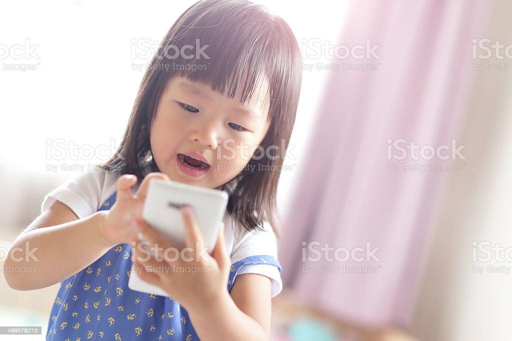 happy girl with smart phone stock photo